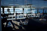 The MV Elwha ferry serving Anacortes and the San Juan Islands is reflected in its sister ferry leaving for Orcas Island, Wash., on July 25, 2010.