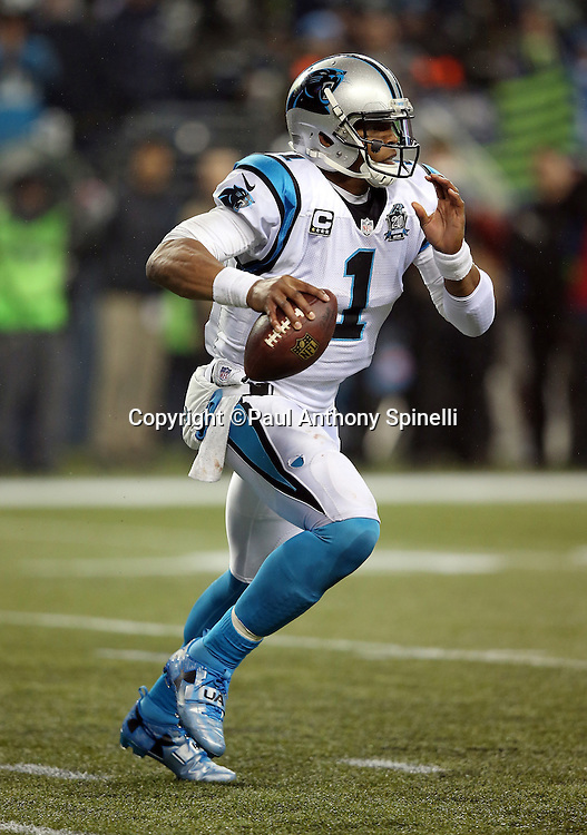 Carolina Panthers quarterback Cam Newton (1) rolls right as he looks to throw a fourth quarter pass during the NFL week 19 NFC Divisional Playoff football game against the Seattle Seahawks on Saturday, Jan. 10, 2015 in Seattle. The Seahawks won the game 31-17. ©Paul Anthony Spinelli