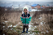 The little daughter of Rudo (25) walking up a little hill, in the back the construction side of the familie's selfconstructed buildings in Rankovce. Since almost two years (01/2016) the familie's are already able to life in the houses. They joined a micro loan program supported by the Slovak NGO ETP Slovakia in Rankovce.