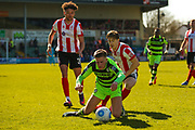 Forest Green Rovers midfielder, on loan from Birmingham City, Charlie Cooper (20) is fouled during the Vanarama National League match between Lincoln City and Forest Green Rovers at Sincil Bank, Lincoln, United Kingdom on 25 March 2017. Photo by Simon Davies.