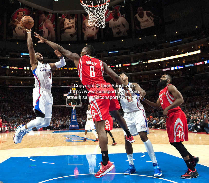 Feb. 11, 2015 - Los Angeles, CA, USA - Los Angeles Clippers' Chris Paul drives the lane against Houston Rockets' Joey Dorsey during the first half at Staples Center in Los Angeles on Wednesday