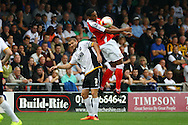 Crewe Alexandra&rsquo;s Vadaine Oliver chests the ball under pressure from Port Vale&rsquo;s Carl Dickinson. Skybet football league one match, Crewe Alexandra v Port Vale at the Alexandra Stadium in Crewe on Saturday 13th Sept 2014.<br /> pic by Chris Stading, Andrew Orchard sports photography.