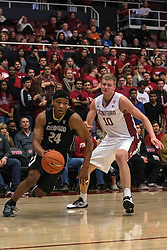 Colorado guard George King (24) drives past Stanford forward Michael Humphrey during the first half of an NCAA college basketball game in Stanford, Calif., Sunday, Jan. 3, 2016. Colorado won 56-55. (AP Photo/Jason O. Watson)