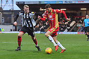 Grimsby Town defender Ludvig Ohman (5) and MK Dons midfielder Alex Gilbey (8) during the EFL Sky Bet League 2 match between Grimsby Town FC and Milton Keynes Dons at Blundell Park, Grimsby, United Kingdom on 26 January 2019.