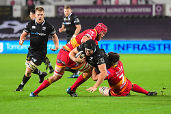 Ospreys' James King is tackled by Dragons' James Benjamin and Joseph Davies - Mandatory by-line: Craig Thomas/JMP - 27/10/2017 - RUGBY - Liberty Stadium - Swansea, Wales - Ospreys v Dragons - Guinness Pro 14