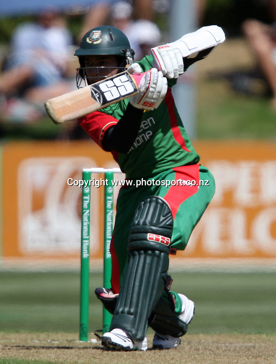 Mushfiqur Rahim lashes out on his way to scoring 50 runs.<br /> Cricket - 2nd ODI New Zealand Black Caps v Bangladesh, 8 February 2010, University Oval, Dunedin, New Zealand.<br /> International Cricket Season 2009/2010<br /> Photo: Rob Jefferies/PHOTOSPORT