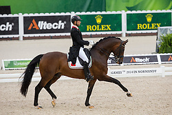 Yessin Rahmouni, (MAR), Floresco NRW - Grand Prix Team Competition Dressage - Alltech FEI World Equestrian Games™ 2014 - Normandy, France.<br /> © Hippo Foto Team - Leanjo de Koster<br /> 25/06/14
