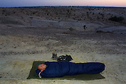 GOBI DESERT, MONGOLIA..08/29/2001.Mount Burkhan Khailaast. Paul Friedrich, German tour operator, in his sleeping bag at sunrise..(Photo by Heimo Aga).