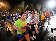 Despite a steady rain, runners begin the Publix Georgia Marathon & Half Marathon at Dominique Wilkins Lane on Sunday, March 22, 2015, in Atlanta. David Tulis / AJC Special