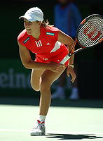 Tennis, MELBOURNE, AUSTRALIA - JANUARY 19:  Justine Henin-Hardenne of Belgium in action against Olivia Lukaszewicz of Australia during day one of the Australian Open January 19, 2004 in Melbourne, Australia.