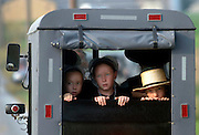 A group of Amish children ride to a ceremony for victims of the Amish school shootings, in Nickel Mines, Pennsylvania.