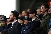 Preston North End  fans in hats watching the game during the EFL Sky Bet Championship match between Fulham and Preston North End at Craven Cottage, London, England on 4 March 2017. Photo by Matthew Redman.