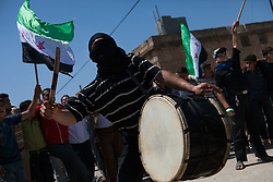 A demonstrator playing drums in a demonstration against the Syrian regime taking place in Atareb, 30km, west of Aleppo, north west  Syria, friday, 27 April, 2012..*A city well controlled by the Syrian regime were two days ago a person died by the shot of an Sniper and other got injured in the leg. activist reports, Syria, April 27, 2012. Photo by Daniel Leal-Olivas / i-Images.