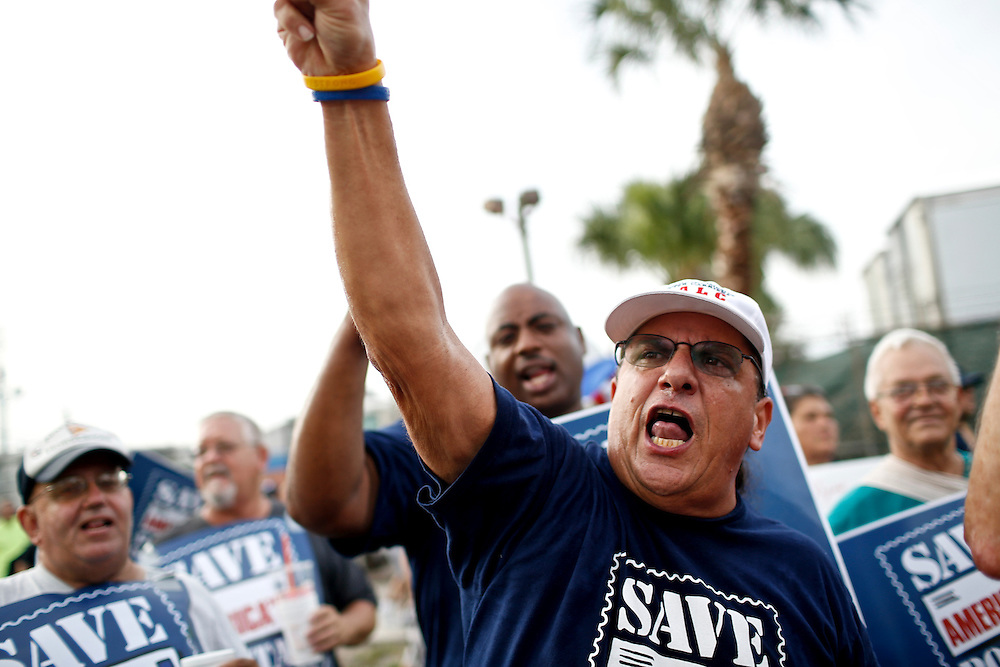 """Sam Santilli, 55, participates in the Florida American Federation of Labor and Congress of Industrial Organizations (AFL-CIO) rally shows off her tattoo during the 2012 Republican National Convention on August 29, 2012 in Tampa, Fla. Santilli said he was """"union made,"""" his mother and father were both union workers in Pittsburgh. He's continued the tradition throughout his life as a steel worker and letter carrier."""