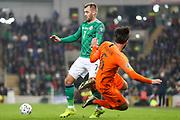 Netherlands midfielder Davy Propper (6) goes down under pressure from Northern Ireland forward Niall McGinn (7)  during the UEFA European 2020 Qualifier match between Northern Ireland and Netherlands at National Football Stadium, Windsor Park, Northern Ireland on 16 November 2019.