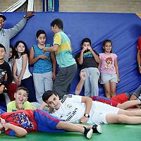 Nederland, Hoofddorp , 30 september 2014.<br /> Oud Nederlands-surinaamse voetballer hier in een sportzaaltje in Hoofddorp om allochtone buurt kinderen na school te helpen met bewegen en sporten.<br /> Foto:Jean-Pierre Jans