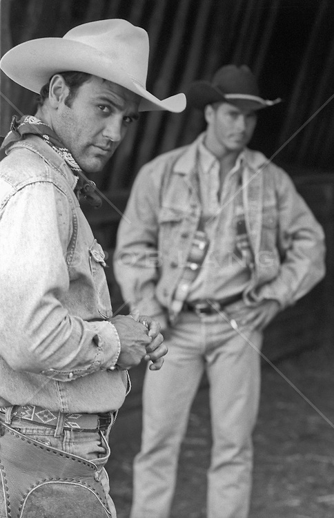 handsome cowboys in a barn