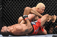 "ATLANTA, GEORGIA, SEPTEMBER 6, 2008: Roan Carneiro (left) attempts a kimura submission hold on Ryo Chonan during ""UFC 88: Breakthrough"" inside Philips Arena in Atlanta, Georgia on September 6, 2008"