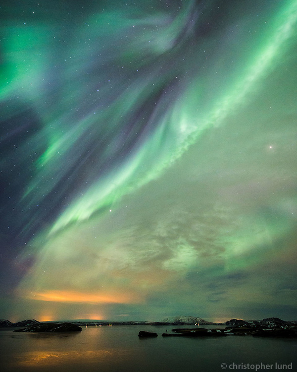 Northern Lights - Aurora Borealis over Lake Þingvallavatn. Looking east over Klumba and Island Nesjaey. South Iceland.