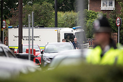 © Licensed to London News Pictures . 30/05/2017 . Wigan , UK . Police raid a house at 5 Springfield Street , Wigan . It is believed the raid is in connection with the investigation in to a murderous bomb attack at an Ariana Grande gig at Manchester Arena on Monday 22nd May . Photo credit : Joel Goodman/LNP