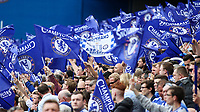 Football - 2014 / 2015 Premier League - Chelsea vs. Sunderland.   <br /> <br /> Chelsea fans wave flags in celebration at their title win at Stamford Bridge. <br /> <br /> COLORSPORT/DANIEL BEARHAM