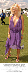 TV presenter MISS HANNAH SANDLING, at a polo match in Berkshire on 27th July 2003.PLU 195