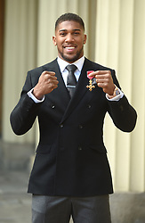 December 20, 2018 - London, London, United Kingdom - Image licensed to i-Images Picture Agency. 20/12/2018. London, United Kingdom. Boxer Anthony Joshua with his award after an Investiture at Buckingham Palace in London. (Credit Image: © Pool/i-Images via ZUMA Press)