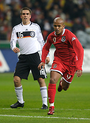 FRANKFURT, GERMANY - Wednesday, November 21, 2007: Wales' Robert Earnshaw and Germany's Philipp Lahm during the final UEFA Euro 2008 Qualifying Group D match at the Commerzbank Arena. (Pic by David Rawcliffe/Propaganda)