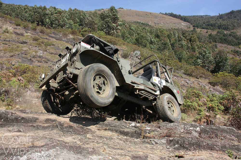 WW11 vintage Willys Jeep offroading in the mountains of Munnar, Kerala, India