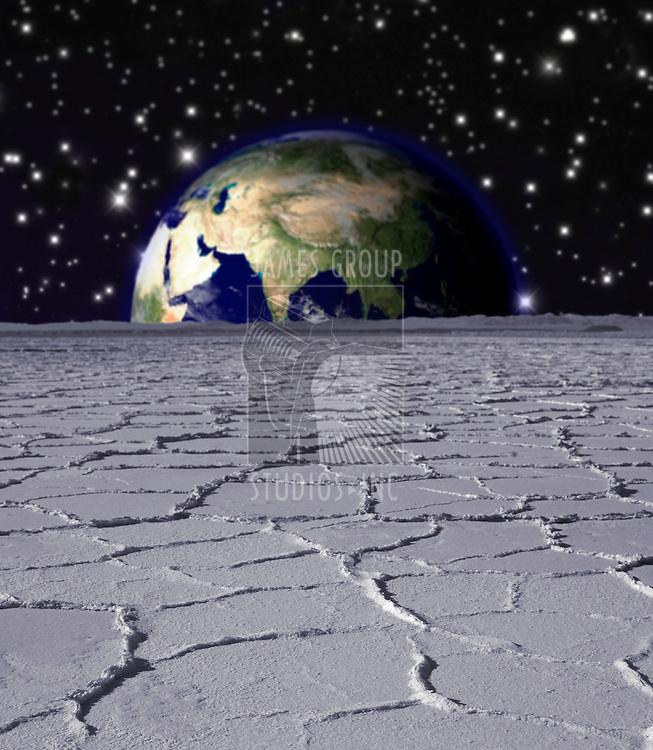 Earth rising over a lunar landscape