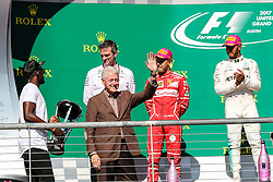 October 22, 2017 - Austin, Texas, U.S - Mercedes driver Lewis Hamilton (44) of Great Britain, Ferrari driver Kimi Raikkonen (7) of Finland and Ferrari driver Sebastian Vettel (5) of Germany on the podium after the Formula 1 United States Grand Prix race at the Circuit of the Americas race track in Austin,Texas. (Credit Image: © Dan Wozniak via ZUMA Wire)