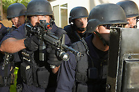 Swat officers aiming guns