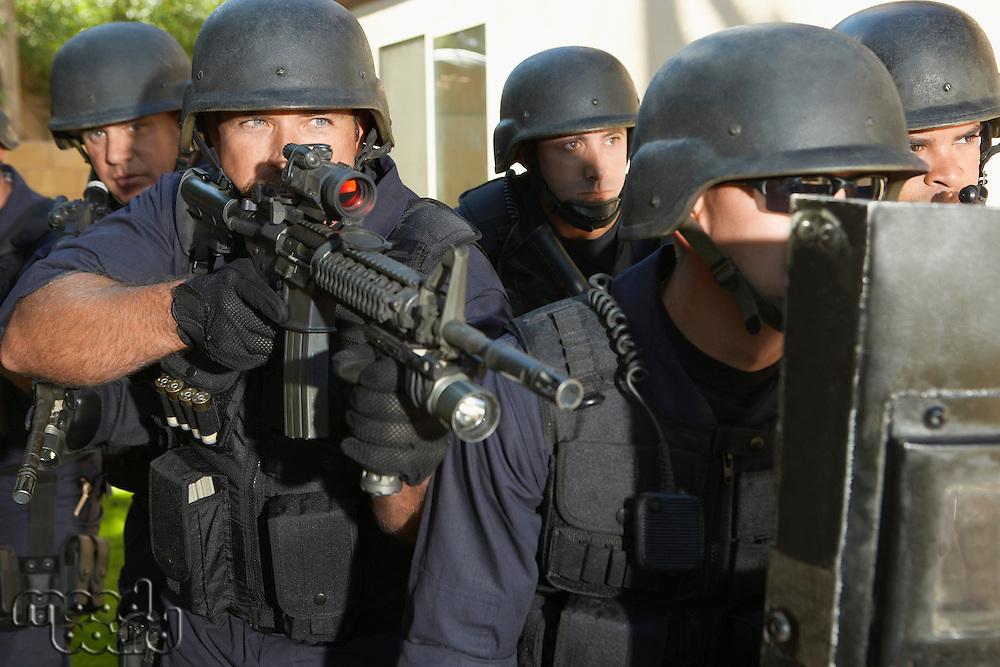 Swat officers aiming guns