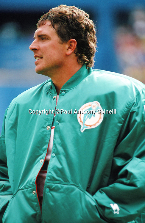 Miami Dolphins quarterback Dan Marino (13) looks on from the sideline during the NFL football game against the Pittsburgh Steelers on Sept. 30, 1990 in Pittsburgh. The Dolphins won the game 28-6. (©Paul Anthony Spinelli)