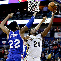 Dec 8, 2016; New Orleans, LA, USA; New Orleans Pelicans guard Buddy Hield (24) shoots over Philadelphia 76ers forward Richaun Holmes (22)  during the second half of a game at the Smoothie King Center.  The 76ers defeated the Pelicans 99-88. Mandatory Credit: Derick E. Hingle-USA TODAY Sports