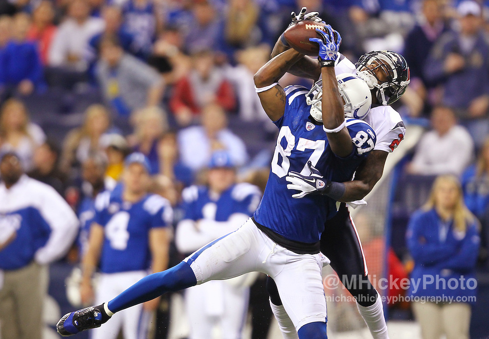 Dec. 22, 2011; Indianapolis, IN, USA; Indianapolis Colts wide receiver Reggie Wayne (87) goes up to make a catch as Houston Texans cornerback Kareem Jackson (25) defends from behind to set up the game winning touchdown at Lucas Oil Stadium. Indianapolis defeated Houston 19-16. Mandatory credit: Michael Hickey-US PRESSWIRE