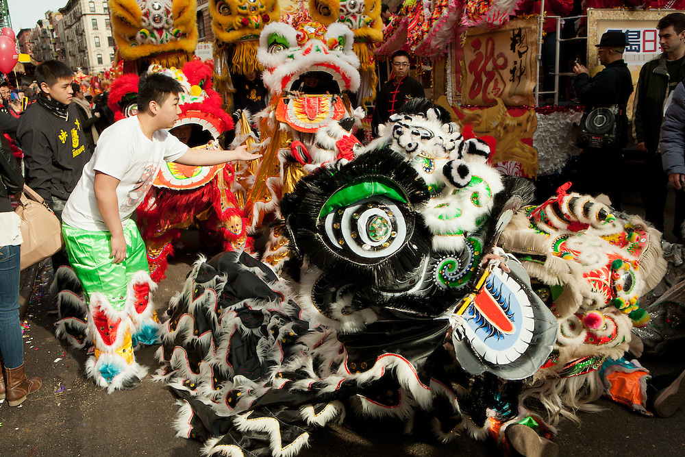 Organizing dragons on Mott Street prior to the start of the parade.