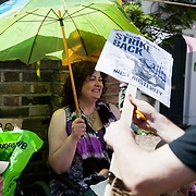 UK Uncut holding their own Mother of all street Parties outside Deputy Prime Minister Nick Clegg's  house in Putney. After initial scuffles with police the party was allowed to go on.