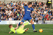 Dannie Bulman of AFC Wimbledon and Hartlepool United midfielder Michael Woods battle during the Sky Bet League 2 match between AFC Wimbledon and Hartlepool United at the Cherry Red Records Stadium, Kingston, England on 31 October 2015. Photo by Stuart Butcher.