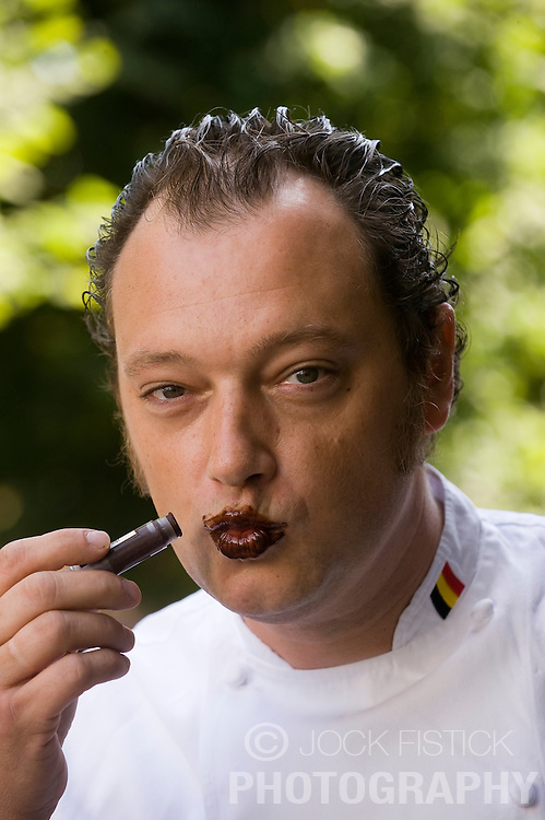 Dominique Persoone is the managing director of The Chocolate Line, and shows off one of his favorite products, chocolate lipstick, in Bruges, Belgium on Tuesday, Sept. 9, 2008. (Photo © Jock Fistick)