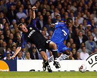 Photo: Chris Ratcliffe.<br />Chelsea v Anderlecht. UEFA Champions League.<br />13/09/2005.<br />Bart Goor of Anderlecht goes in hard on Micheal Essien of Chelsea