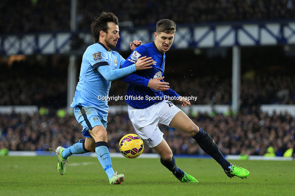 10th January 2015 - Barclays Premier League - Everton v Manchester City - John Stones of Everton battles with David Silva of Man City - Photo: Simon Stacpoole / Offside.