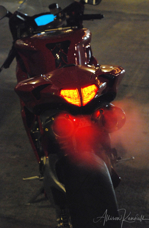 Motorcycles light up the night while cruising Cannery Row in Monterey