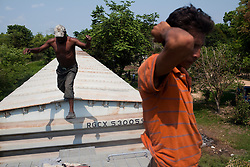 Migrants ride on top of a freight train that left from Tenosique, Tabasco.  Tenosique is the starting point for migrants who will travel on top of a freight train north to the border with the United States. The trip for these migrants, mostly from Central America,  has become increasingly dangerous over the past several years as Mexico's drug war has raged and kidnappings and killings of migrants has increased.