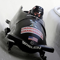 28 February 2007:    The USA 1 bobsled driven by Steven Holcomb with sidepushers Justin Olsen and Steve Mesler, and brakeman Curtis Tomasevicz goes through run 19 in the 1st turn at the 4-Man World Championships competition on February 27 at the Olympic Sports Complex in Lake Placid, NY.