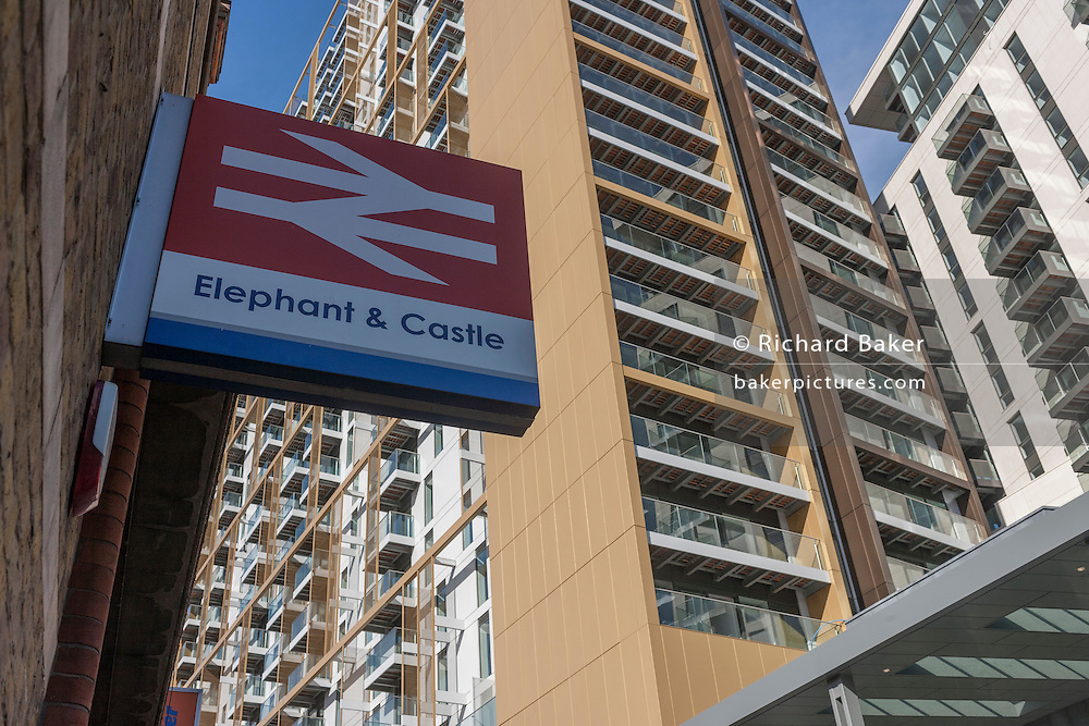 An old Network Rail sign below newly-completed apartments and flats in the regenerated development at Elephant & Castle, south London.