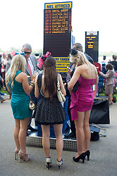© licensed to London News Pictures. 14/06/2011. Ascot, UK.  Punters place bets before the 5:00pm race on day one at Royal Ascot races today (14/03/2011). The 5 day showcase event,  one of the highlights of the racing calendar is in it's 300th year. Horse racing has been held at the famous Berkshire course since 1711 and tradition is a hallmark of the meeting. Top hats and tails remain compulsory in parts of the course. Photo credit should read: Ben Cawthra/LNP