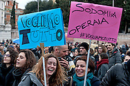 """Two supporter of LGBT associations holds placards reading """"we want everything"""" and """"sodomy worker"""".<br /> Rally in central Rome of LGBT associations, for call for more rights for homosexual couples, the protest  after approval of the bill on civil union  which was approved recently by  the Italian Senate. Rome, Italy 5th March 2016"""
