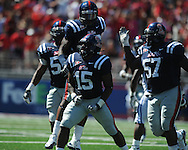 Kentucky's Moncell Allen (30) is tackled by Ole Miss linebacker Joel Kight (15) at Vaught-Hemingway Stadium in Oxford, Miss. on Saturday, October 2, 2010. Ole Miss won 42-35 to improve to 3-2..