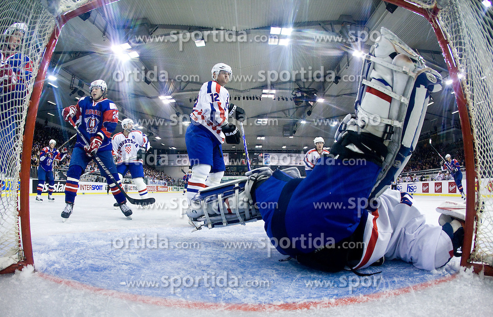 TICAR Rok of Slovenia, BELIC Sasa of Croatia  and BELIC Vanja of Croatia  at IIHF Ice-hockey World Championships Division I Group B match between National teams of Slovenia and Croatia, on April 18, 2010, in Tivoli hall, Ljubljana, Slovenia.  (Photo by Vid Ponikvar / Sportida)